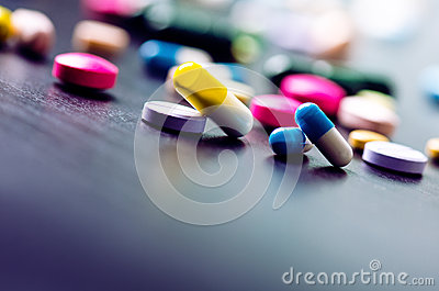 Pharmacy background on a black table. Tablets on a black background. Pills. Medicine and healthy. Close up of capsules. Differend
