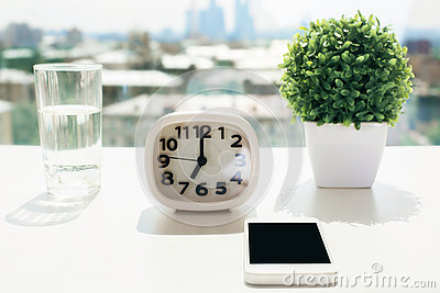 Desktop with clock and phone
