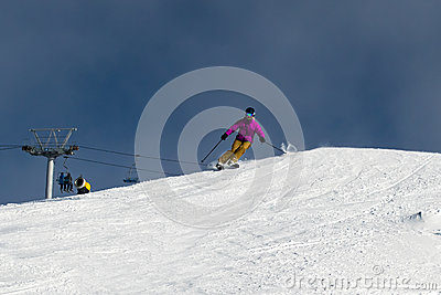 Female skier carving down an Australian ski slope