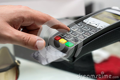 Credit or debit card password payment. Customer hand is entering