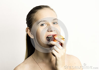 Beautiful naked young woman eating an apple. healthy food - strong teeth concept