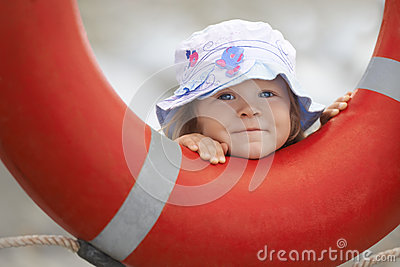 Child peeking out of the lifebuoy