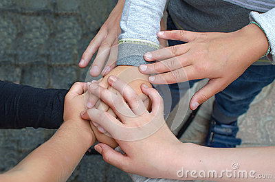 Childrens hands in a circle