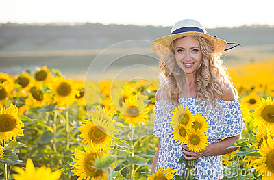 Portrait of the beautiful girl with a sunflowers