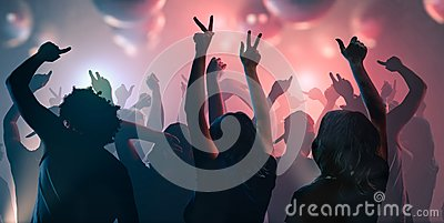 Nightlife and disco concept. Young people are dancing in club