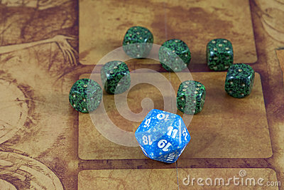 One clear blue dice with seven green dices