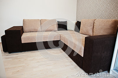 Bicolor cofee corner sofa bed at light room