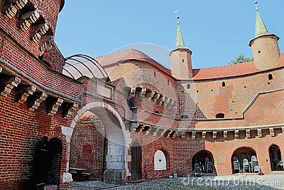 View of famous barbakan in Cracow, Poland. Courtyard. Part of the city wall fortification.