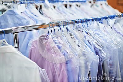 Weighs clean clothes on hangers and Packed