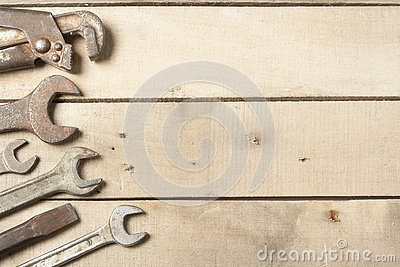 Set of construction tools. Wrench on wooden background