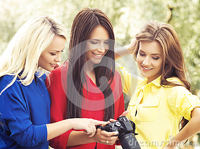 Girls looking at photos on a camera