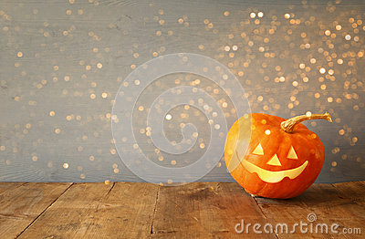 Halloween holiday concept. Cute pumpkin on wooden table