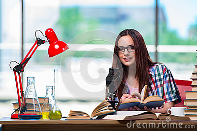 The female student preparing for chemistry exams