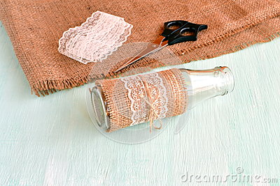 Handmade empty vase, scissors, burlap, lace. Set for handmade vase. How to make vase. Simple and cheap DIY recycled material