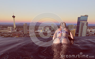 Woman enjoying the city view of Las Vegas from infinity pool