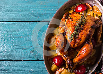 Homemade Roasted Thanksgiving Day Turkey on bright blue wooden background.