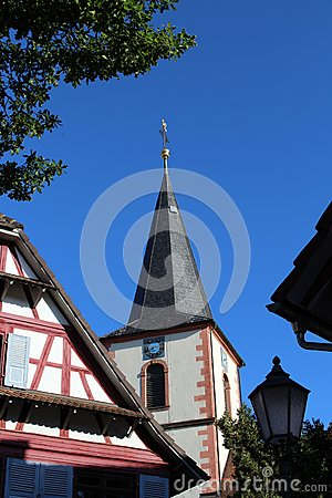 Half-timbered house and church in Kehl-Kork.