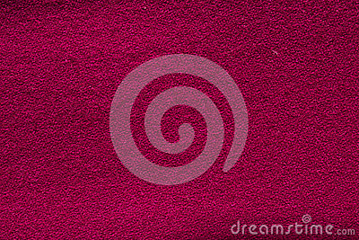 Close up crimson woollen knitted fabric texture. Loden background