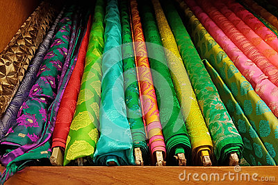 Vibrant colored textured fine silk cloth material rolls