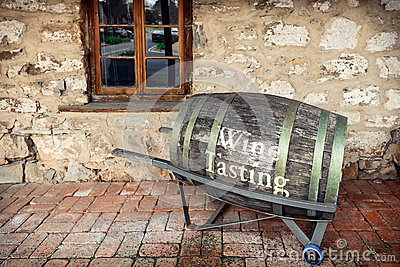 Old barrel with wine tasting text