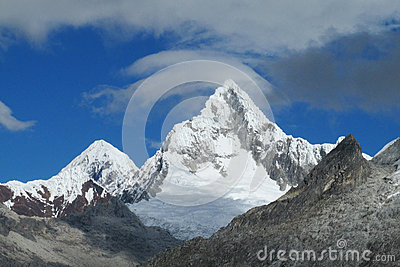 Rocky and snow ice covered mountain range of Cordillera Blanca in the Andes