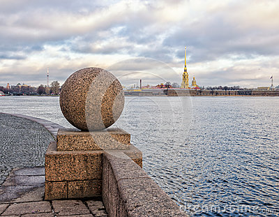 A distant view of Peter and Paul Fortress from behind the granite ball of The Spit of Vasilievsky island.