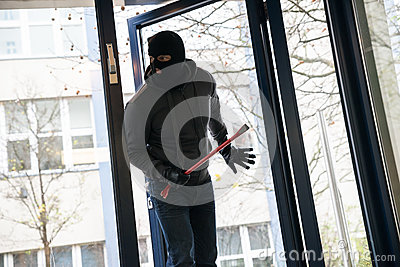 Man With Crowbar Entering Into House