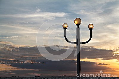 Lamppost and sunset sky