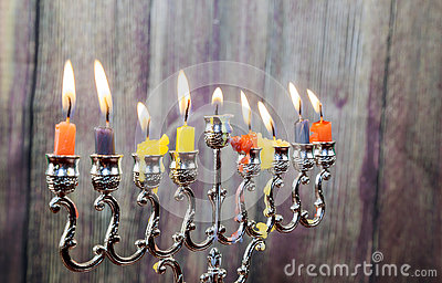 Chanukah candles all in a row. Bright, shiny the Jewish holiday.