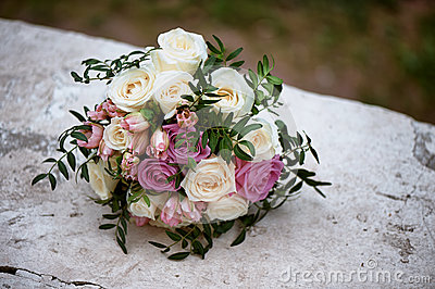 Bridal bouquet of cream and pink roses. floristry