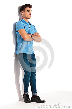 Man leaning against studio wall with hands crossed
