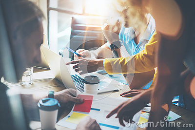 stock image of young group coworkers making great business decisions.marketing team discussion corporate work concept studio.new