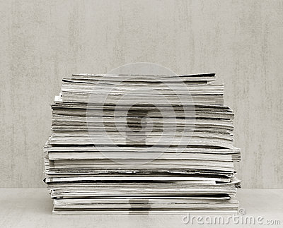 A large stack of magazines close-up