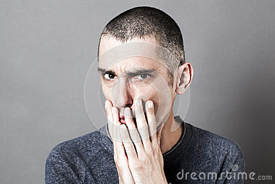 Stressed out unhappy man having doubts, showing suspicion and disappointment