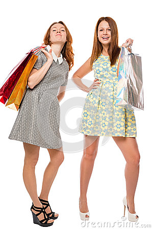 Beautiful girl in dress with shopping bags