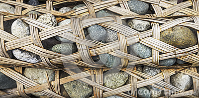 Bamboo weaved container full of pebbles called Longshi