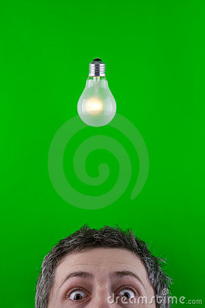 Man and electric light bulb