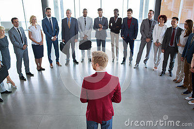 Leader standing in front of his successful business team