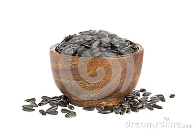 Black sunflower seeds in bowl isolated on white background