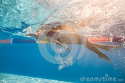 Swimmer in back crawl style underwater