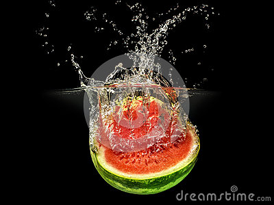 Fresh melon falling in water with splash on black background