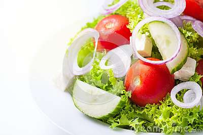 Homemade greek or summer salad with fresh vegetables in a plate