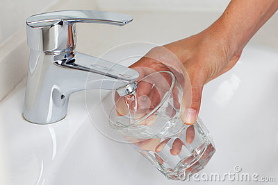 Puring in water in a glass