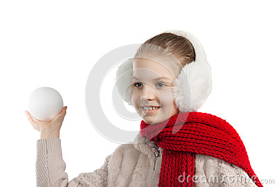 Pretty joyful little girl in warm winter things with knitted scarf