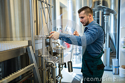 Brewer working at brewery