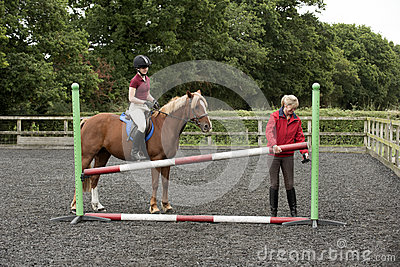 Building a fence at a riding school