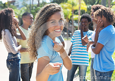 Argentinian girl with friends pointing at camera