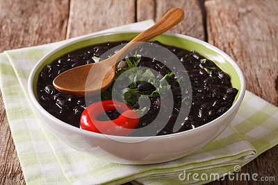 Vegetarian black bean soup close up in a bowl. horizontal