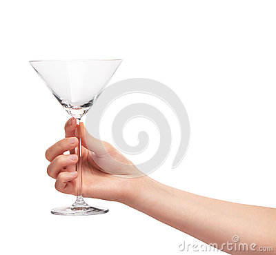 Female hand holding empty clean transparent martini glass