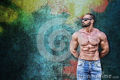 Handsome Muscular Shirtless Hunk Man Against Colorful Background